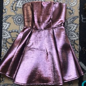 Sexy Rocker strapless metallic gold rose dress.